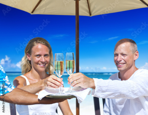A couple celebrating on the beach