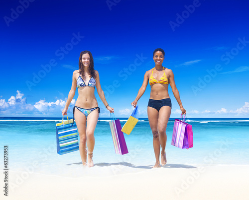 Women with shopping bags on a tropical beach