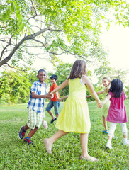Cheerful Children Playing Outdoors
