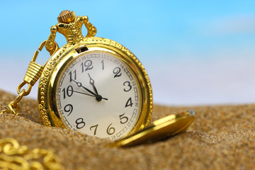 Pocket clock on the beach