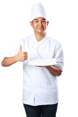 Young cook keeps an empty plate with thumb up