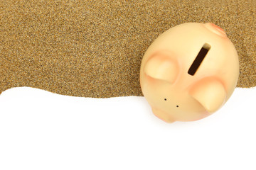 Summer piggy bank on the sand