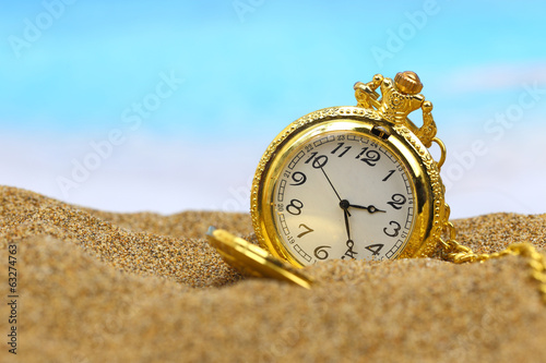 Pocket clock on the beach