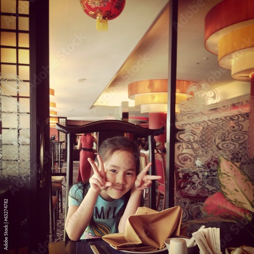 cute girl in the chinese restaurant
