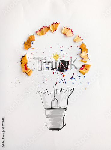 hand drawn light bulb word design THINK with pencil saw dust on