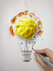 hand drawing  light bulb and crumpled paper with pencil saw dust