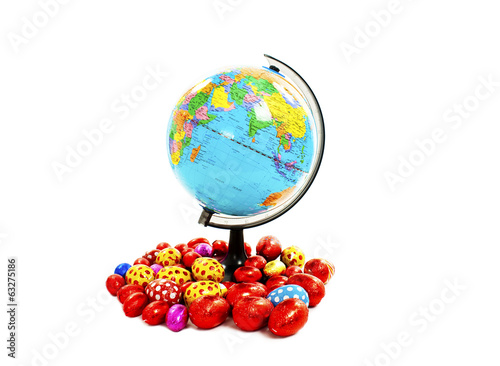 Colorful chocolate Easter eggs in foil and globe