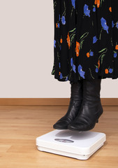 Lightweigh woman over bathroom scales - floating!