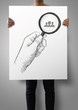 man showing poster of drawing of hand holding magnifier glass lo