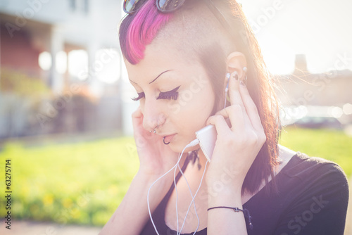 young beautiful punk dark girl listening music
