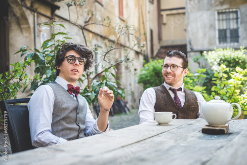two young hipster stylish  men