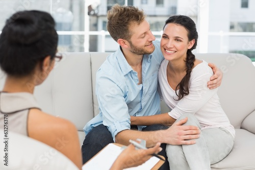 Happy couple reconciling at therapy session