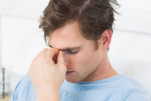 Patient suffering from headache