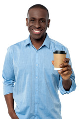 Young man holding beverage cup