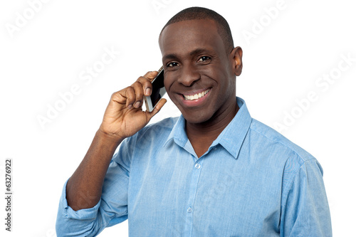 Young handsome guy attending a phone call