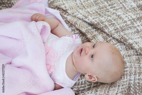 Cute baby lying on blanket