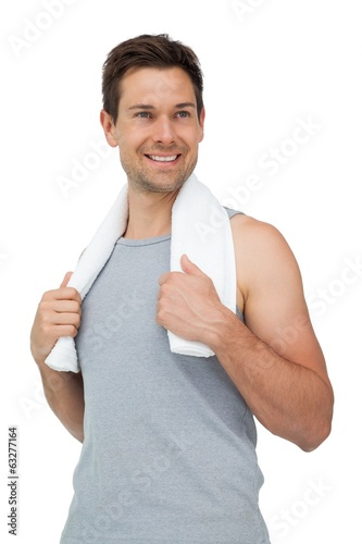 Portrait of a smiling fit young man with towel