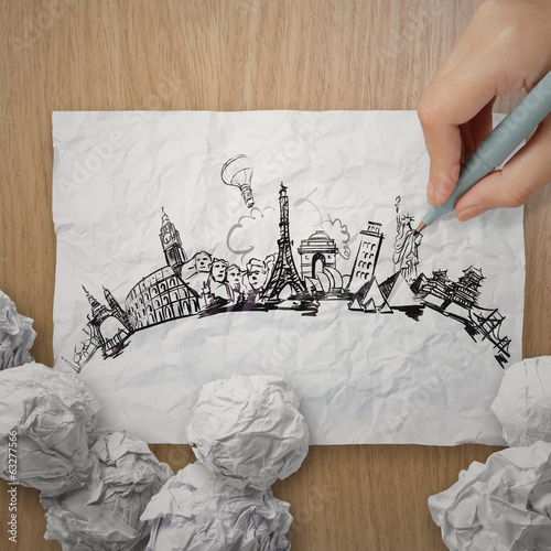 crumpled paper with hand drawn traveling around the world on woo