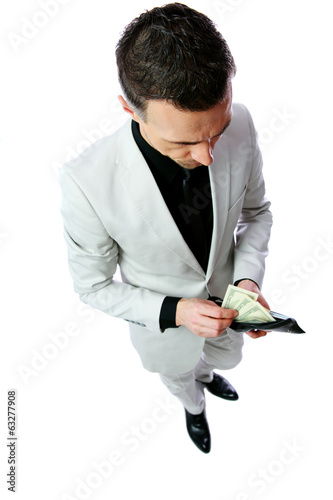Businessman gets money from the wallet
