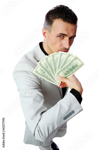 Confident businessman holding US dollars