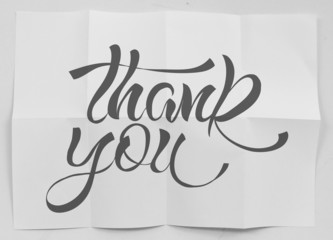 show design word THANK YOU on crumpled paper as concept