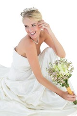 Bride holding bouquet while looking away