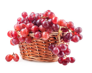 Red grape in basket isolated on white background