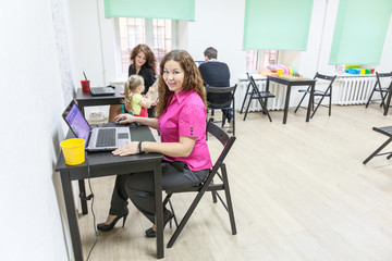 Co-working room with happy working people
