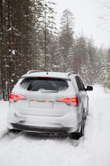 Car on a snowy road, rear view