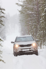 Car riding on snowy road, front view