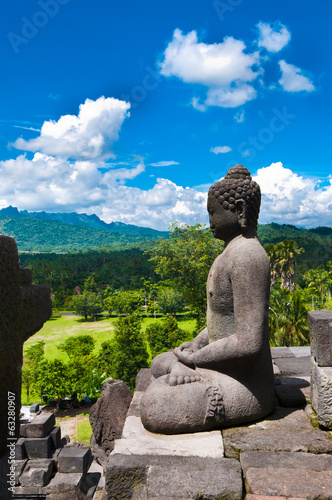 Buddha statue. Mountain on background. Borobudur. Java. Indonesi