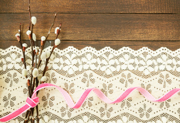 Branches of willow with pink ribbon