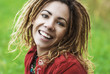 smiling beautiful woman with dreadlocks