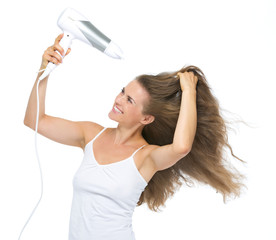 Happy young woman blow-dry