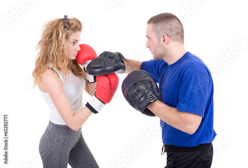 Kickboxing girl with trainer in sparring