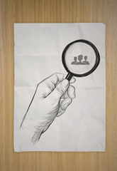 drawing of hand holding magnifier glass looking for employee on
