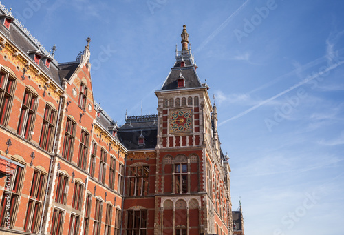 Old building facade of central railroad station in Amsterdam