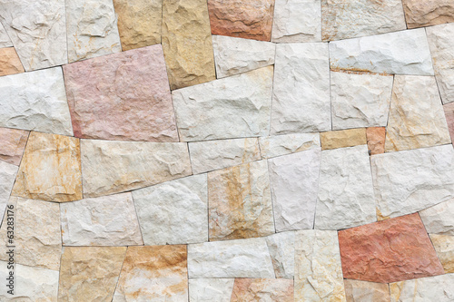 Stone wall background texture with colorful tiling pattern