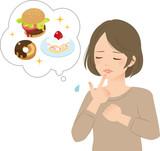 高カロリー食を我慢する若い女性