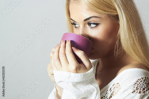 Beautiful woman drinking Coffee.Cup of tea.girl in the Morning