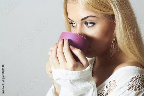Beautiful woman drinking Coffee.Cup of tea.girl in the Morning