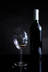 Vine bottle and broken glass on dark background