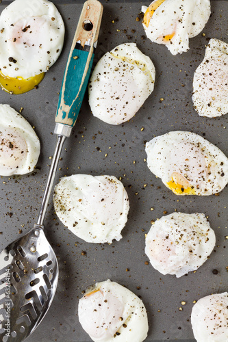 Poached eggs with cracked black pepper