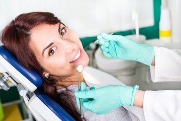 Smiling woman at dentist