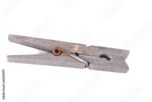 old wooden peg isolated on white