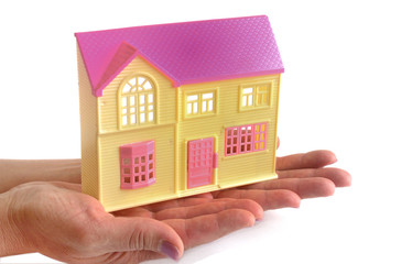 country house model in female hands