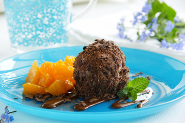 Chocolate ice cream in chocolate chips and oranges.