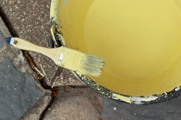 Paint brush with yellow paint