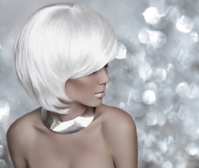 Hairstyle. Fashion blonde woman. White Short Hair. Beautiful gir