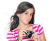 Young girl holding a compact camera with her hair floating
